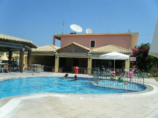 Holidays at Tzevenos Apartments in St George South, Corfu
